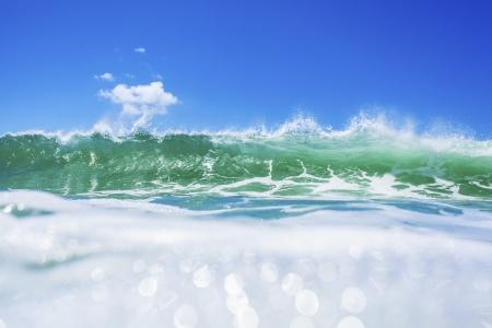 rushing water: Fresh turquise wave breaking Stock Photo