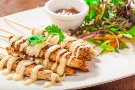 Cajun chicken skewers with mayo and chutney Stock Photo