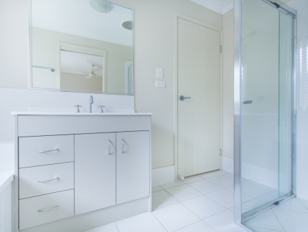 Simple bathroom with sink, mirror and shower photo