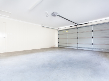 auto garage: Empty double garage with automatic door