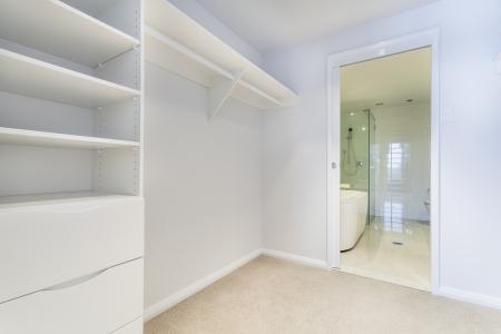 ensuite: Ensuite wardrobe and stylish bathroom Stock Photo