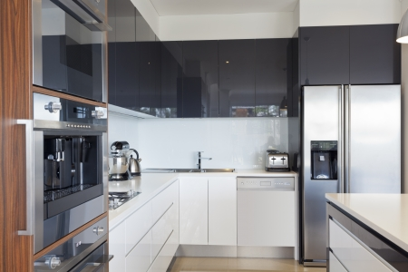 kitchen bench: Modern new kitchen with expensive appliances Stock Photo