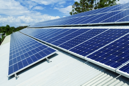 Large solar panel installation on roof Stock Photo