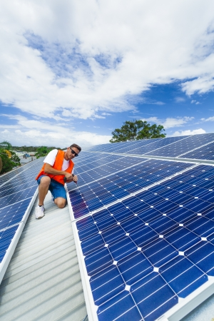 Young technician installing solar panels Stock Photo - 18810910
