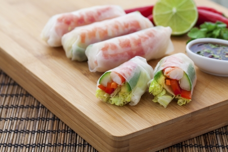 Rice paper rolls with prawns and dipping sauce Stock Photo - 18999481