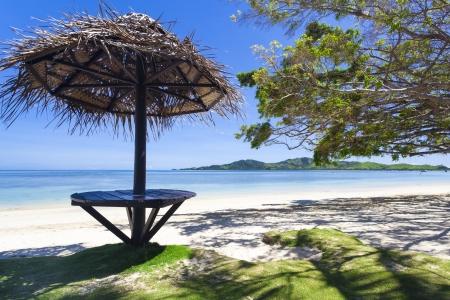 Tropical beach with white sand on Fiji island Standard-Bild
