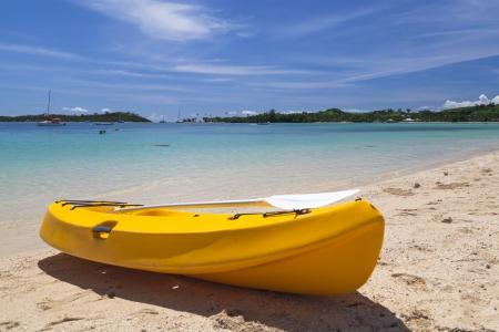 fiji: Canoe on white tropical Fiji beach