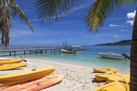 Canoes and jetty on white tropical Fiji beach Stock Photo - 19254389