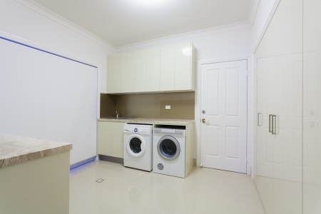 Laundry room in modern house.