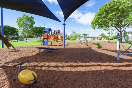 Playground in suburban park photo
