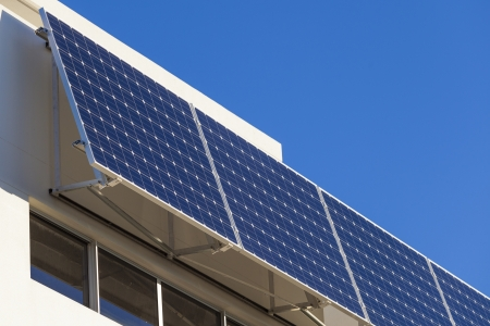 Adjustable solar panel installation on modern home Stock Photo