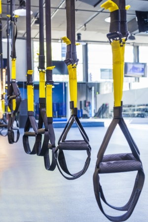Suspention training straps in fitness studio photo