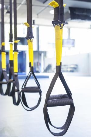 Suspention training bandjes in fitness-studio Stockfoto