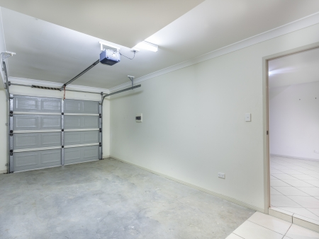 garage door: Empty single garage in home Stock Photo