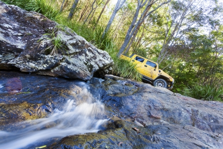 4x4 truck on top a waterfall Stock Photo - 20704608