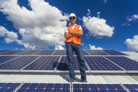 solar roof: Solar power technician on roof
