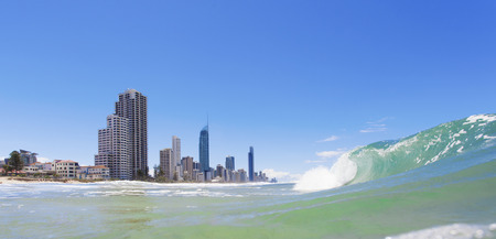 surfers: Waves rolling on Surfers Paradise beach on Gold Coast, Australia Stock Photo