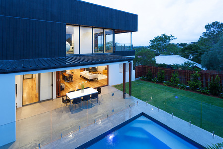 Luxury home with swimming pool at dusk photo