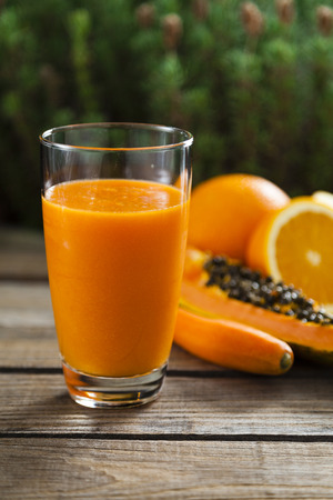 Healthy orange, papaya and carrot smoothie