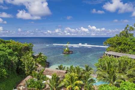samoa: Tropical Samoan resort with clear blue waters, white sand and coconut palms Stock Photo