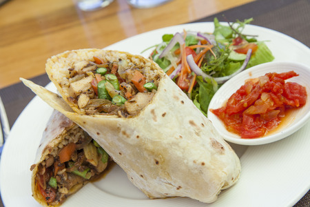 Chicken curry roti wrap with salad and relish