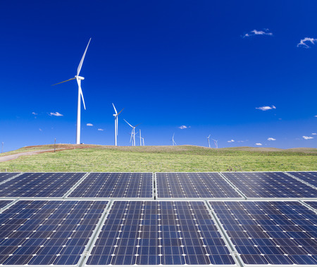 carbon neutral: Sustainable clean energy with solar panels and wind turbines