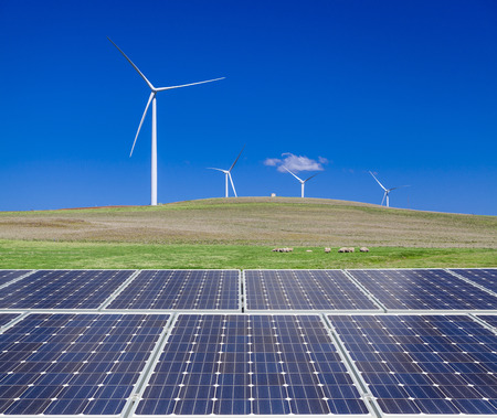 Sustainable clean energy with solar panels and wind turbines photo