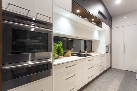 granite kitchen: New LED lit modern kitchen in stylish home Stock Photo