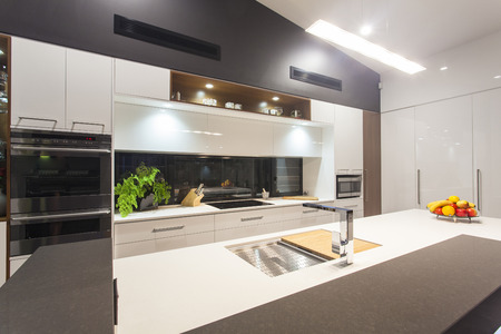appliance: New LED lit modern kitchen in stylish home Stock Photo