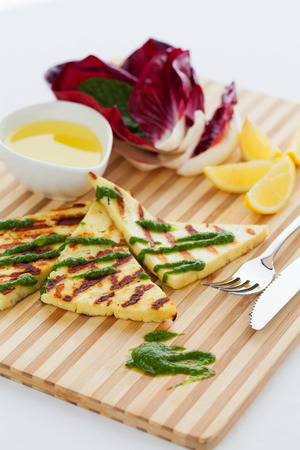 haloumi: Grilled haloumi cheese with a herb oil dressing Stock Photo