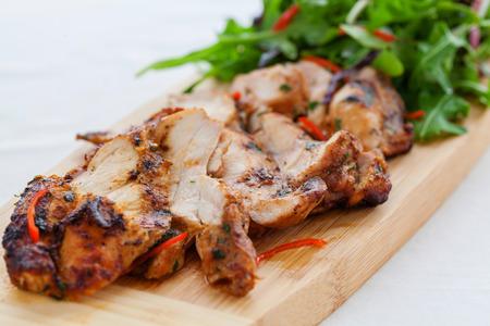 bbq chicken: Grilled spicy chicken thighs and green salad