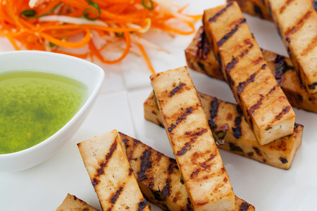 Grilled japanese style tofu slices with dipping sauce