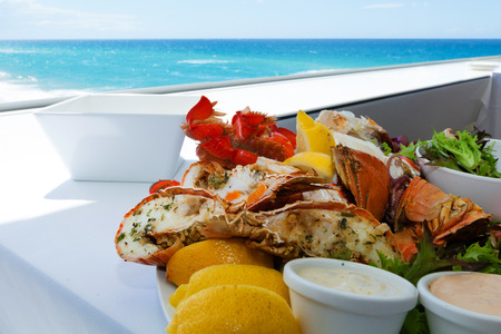 fruit platter: Mixed seafood plate by a tropical beach Stock Photo