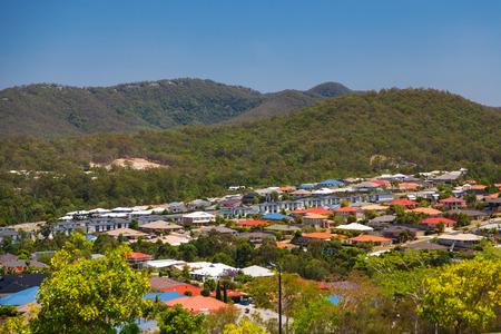 View of suburban Australian homes on sunny hillside photo