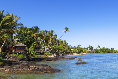 fale: Beach front cabins on tropical Samoan beach Stock Photo