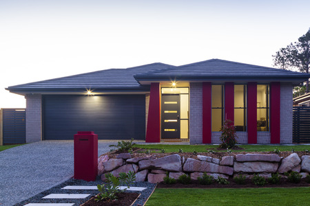 New stylish modern home exterior at dusk photo