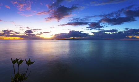 samoa: Sunset and cloudscape over Samoan island Stock Photo