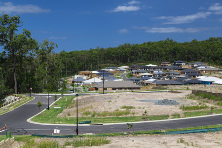 sprawl: New homes being built on fresh land development Stock Photo