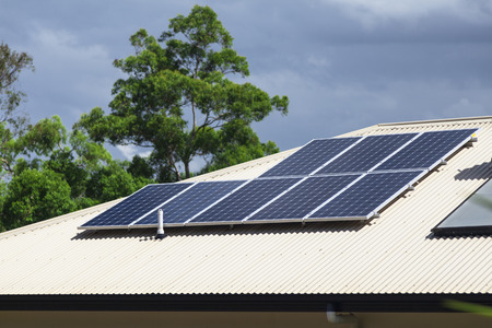 solar panel house: Solar photovoltaic panels installed on aluminium roof Stock Photo