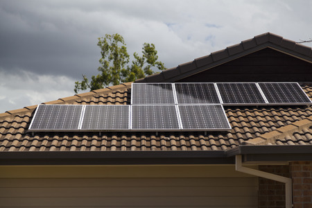 Solar photovoltaic panels installed on tiled roof Stock Photo