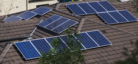 Solar photovoltaic panels installed on tiled roof Banco de Imagens