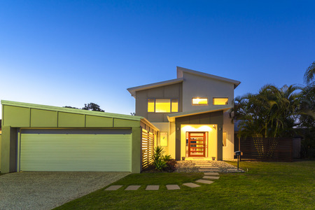 contemporary: New stylish modern home exterior at dusk