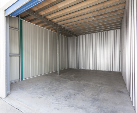 Empty aluminum garage with roller door 스톡 콘텐츠
