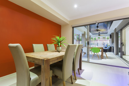 Dining table and outdoor entertaing area in stylish home Stok Fotoğraf