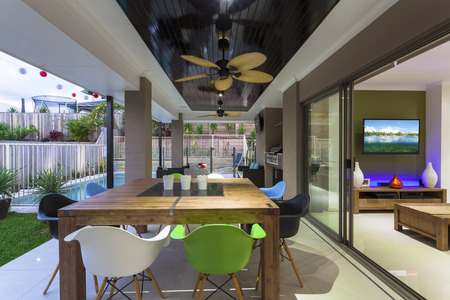 Outdoor entertaining area in stylish home at dusk