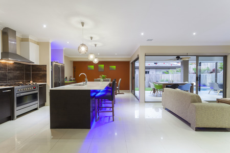 residential home: Stylish home interior with LED lights and outdoor table