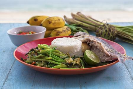 stuffed fish: Banana stuffed fish with asian greens
