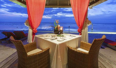 Romantic dinner setting for two on tropical island