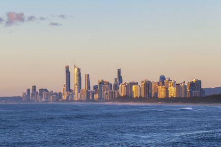 surfers: Golden sunrise over the Gold Coast in Queensland Australia
