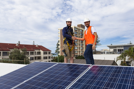 installer: Solar panel technician and client house roof